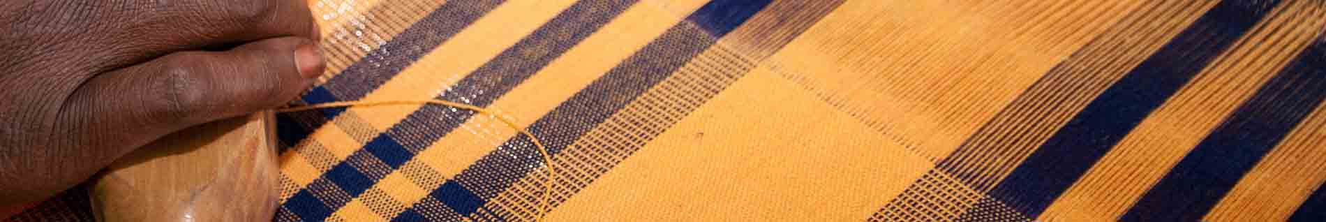 Hand-weaving tartan fabric in Burkina Faso. © Anne Mimault & ITC Ethical Fashion Initiative