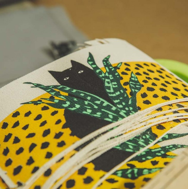 Screen-printed fabric for Karen Walker's cat & pot pouches. © Louis Nderi ITC Ethical Fashion Initiative