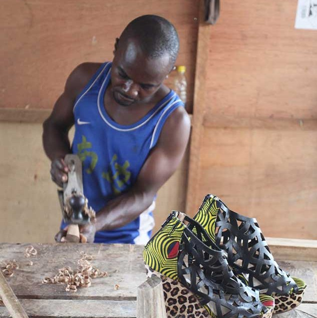 Artisan workin in his wood workshop in Accra working on wooden heels for Ghanaian shoe wear brand, MO SAIQUE © ITC Ethical Fashion Initiative