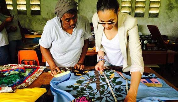 Stella Jean in Haiti working on product development with an artisan © Chloe Mukai