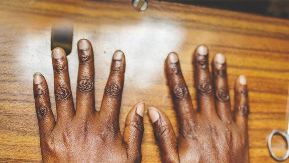 Consider your handprint. Hands at work. © Louis Nderi