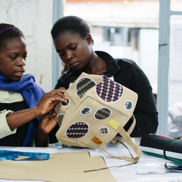 Artisans doing a quality control check of a Carmina Campus bag part of the Autumn/Winter 2014 collection © ITC Ethical Fashion Initiative