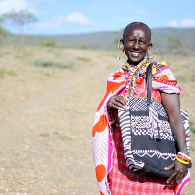 Maasai artisan wearing the MIMCO Afrigraphico bag she contributed to making © Joe Lukhovi - MIMCO