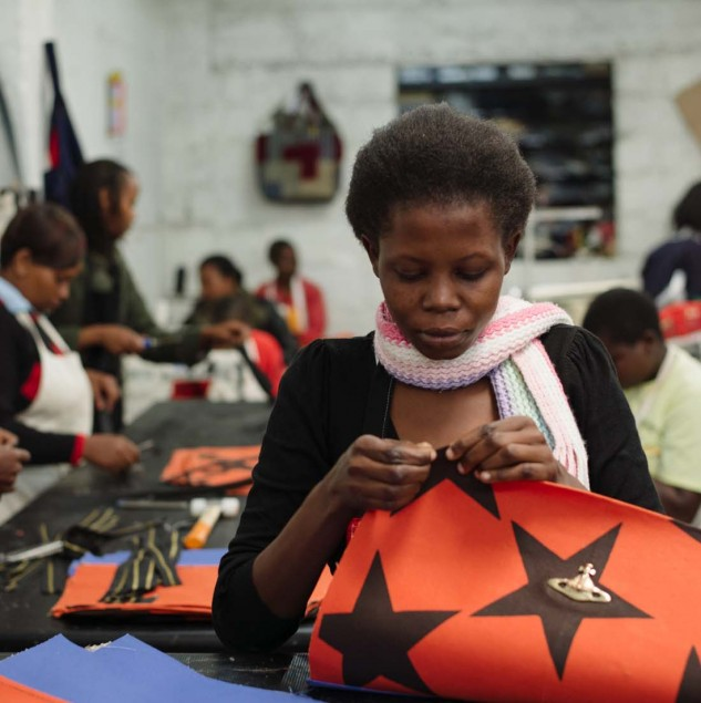 Artisan stitching a Vivienne Westwood start tote part of her Autumn/Winter 2014 collection © Louis Nderi & ITC Ethical Fashion Initiative