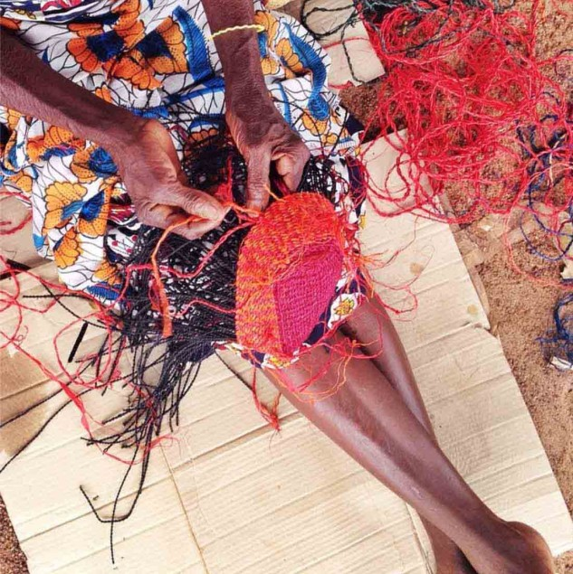 Artisan weaving a colourful AAKS bag in Ghana © AAKS