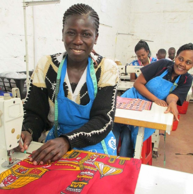 Production for Carmina Campus provides these women with dignified work in an environment where they can learn garment construction and managerial skills. © Tahir Carl Karmali.