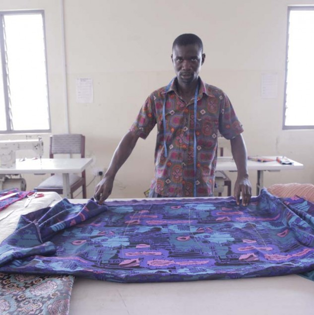 A Christie Brown artisan pattern cutting in the brand's atelier in Accra © ITC Ethical Fashion Initiative