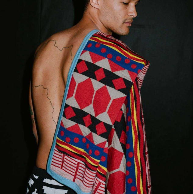 Model wearing a MaXhosa by Laduma design backstage at the Constellation Africa show organised at Pitti Uomo with the Ethical Fashion Initiative © Pitti Immagine & Vanni Bassetti