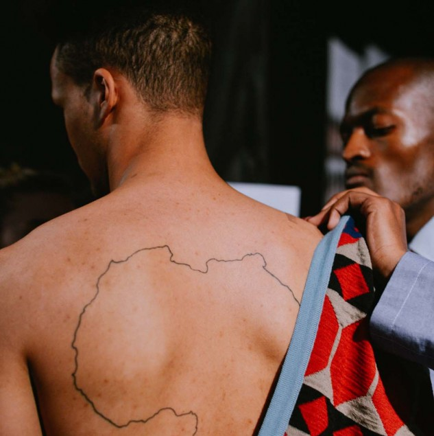 Model wearing MaXhosa by Laduma backstage at Constellation Africa during Pitti Uomo 88 © Pitti Immagine & Vanni Bassetti