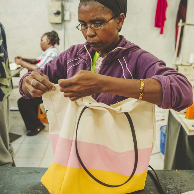 Artisan carrying out a quality control check on Karen Walker's cat & pot bags made by artisans in Kenya © Louis Nderi