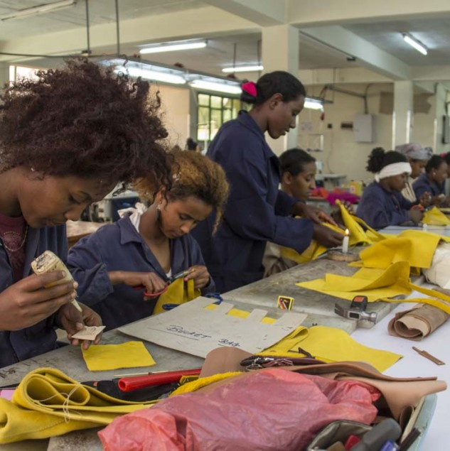 Artisans assembling bags a the HAFDE leather factory in Ethiopia © Israel Seoane González