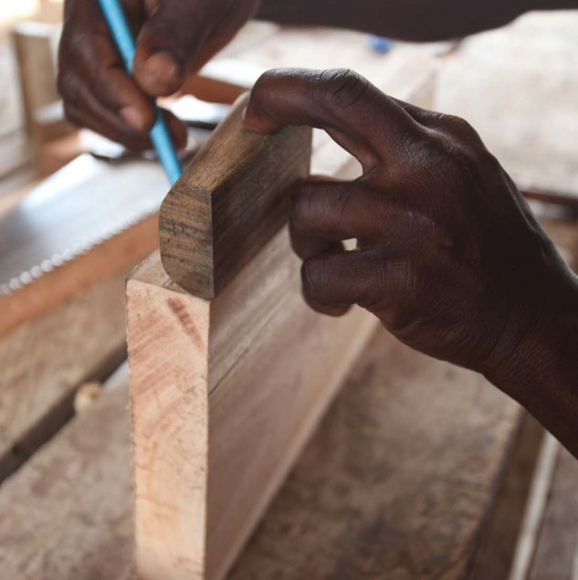 Artisan working on MO SAIQUE's wooden heels in his atelier in Ghana © ITC Ethical Fashion Initiative