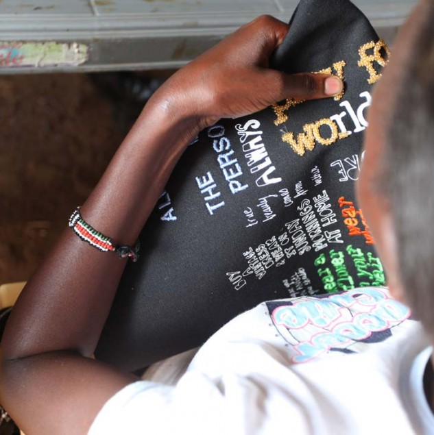 Embroidering a Myer Hands that Shape Humanity bag in Kenya © ITC Ethical Fashion Initiative