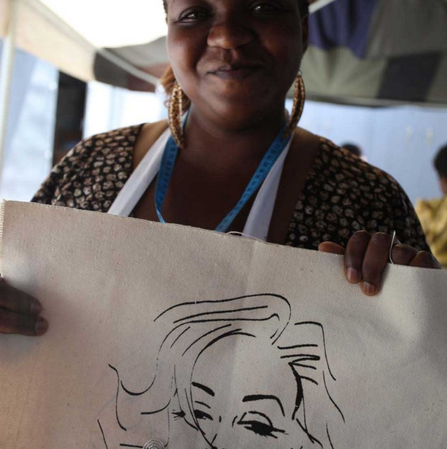 Kenyan artisan showing her screen-printing work for Myer's ethical fashion tote bag © ITC Ethical Fashion Initiative