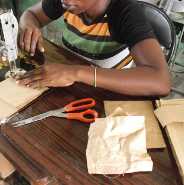Haitian artisan sewing the packaging for the Osklen x Instituto-e collection © ITC Ethical Fashion Initiative
