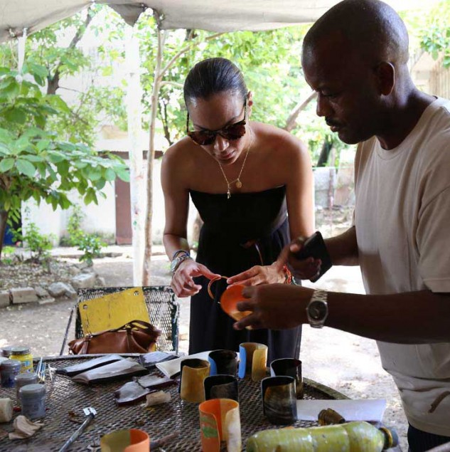 Stella Jean in Haiti workingo on product development with a Haitian artisan © Marie Arago & ITC Ethical Fashion Initiative