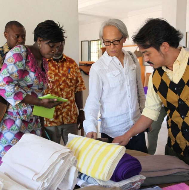 United Arrows team on a sourcing trip in Burkina Faso for their Spring/Summer 2014 men's suit collection where the quality fabrics will be used to construct high-fashion items. © ITC Ethical Fashion Initiative