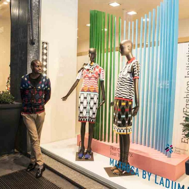 Laduma Ngxokolo next to his Biffi Boutique window in Milan (c) Solange Souza