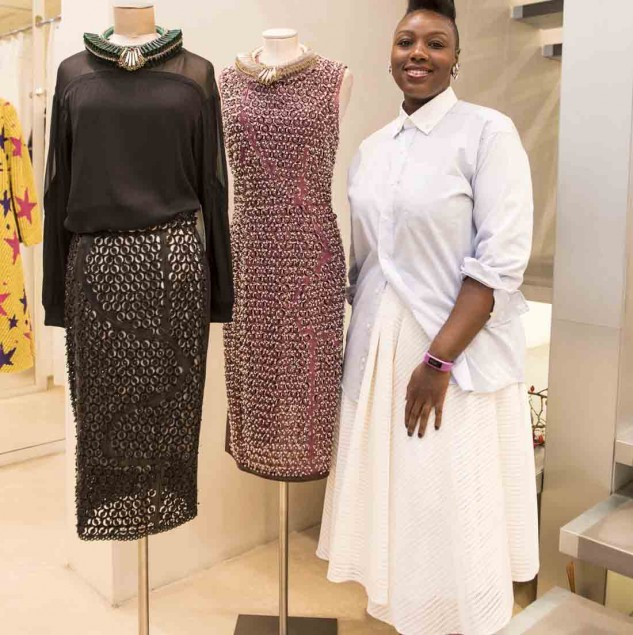 Mimi Plange next to her intricately beaded leather dresses on display at Biffi Boutiques for the Beat of Africa event (c) Solange Souza