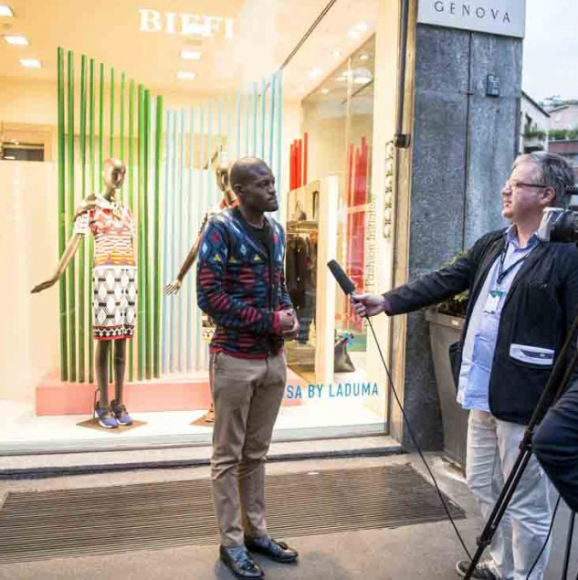 Laduma Ngxokolo of MaXhosa by Laduma being interviewed by Agence France Press in Milan (c) Solange Souza