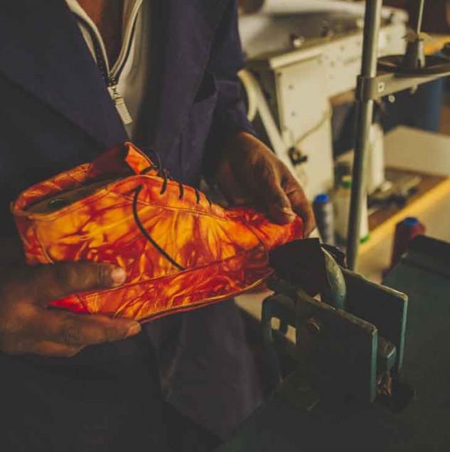 Artisan finishing a Camper x EFI boot © ITC Ethical Fashion Initiative & Louis Nderi